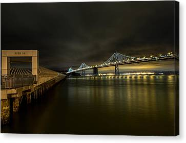 Pier 14 And Bay Bridge At Night Canvas Print by John Daly