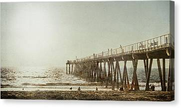 Canvas Print featuring the photograph Pier Approaching Sunset by Kevin Bergen