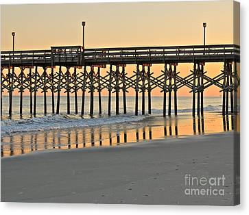 Pier At Sunset Canvas Print by Eve Spring
