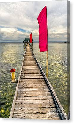 Pier Flags Canvas Print by Adrian Evans