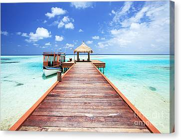 Pier To Tropical Sea In The Maldives - Indian Ocean Canvas Print