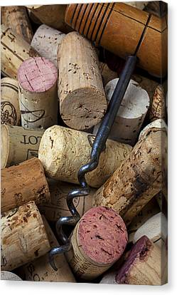 Pile Of Wine Corks With Corkscrew Canvas Print by Garry Gay