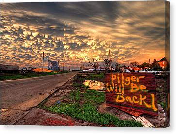 Pilger Will Be Back Canvas Print by Chris Allington