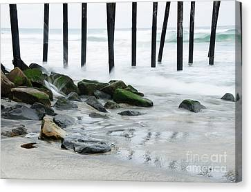 Pilings At Oceanside Canvas Print