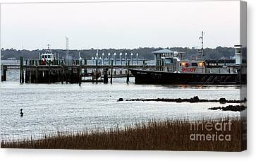Pilot At The Dock Canvas Print by John Rizzuto