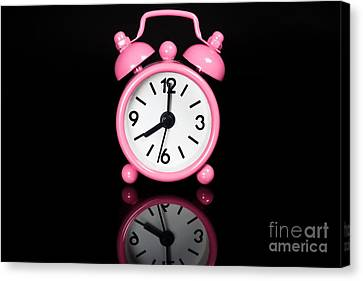 Pink Alarm Clock Canvas Print by Niphon Chanthana