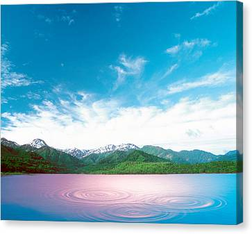 Pink Light Cast Down On Two Rings Canvas Print by Panoramic Images