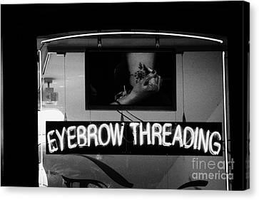 Pink Neon Eyebrow Threading Sign In Shop Window  Canvas Print by Joe Fox