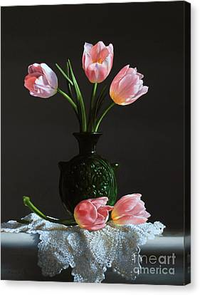 Pink Tulips In A Water Jug Canvas Print by Larry Preston