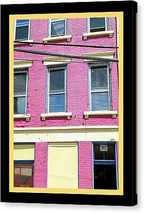 Canvas Print featuring the photograph Pink Yellow Blue Building by Kathy Barney