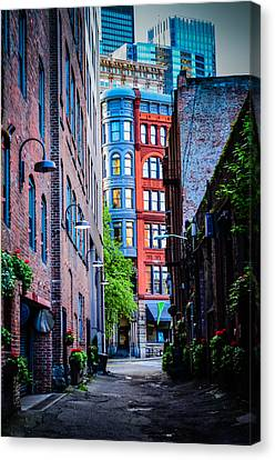 Pioneer Building Through The Alley Canvas Print by Brian Xavier