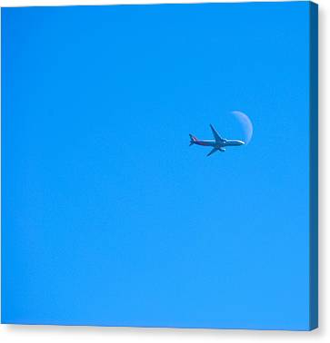Plane Crossing The Moon Canvas Print