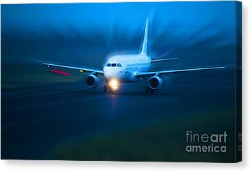 Plane Takes Of At Dusk Canvas Print by Michal Bednarek