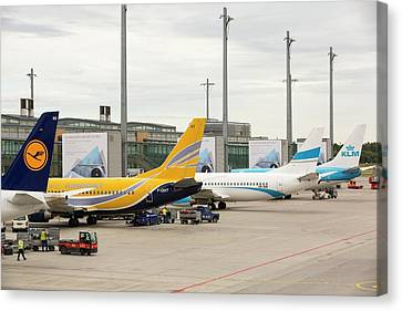 Oslo Canvas Print - Planes On The Tarmac At Oslo Airport by Ashley Cooper