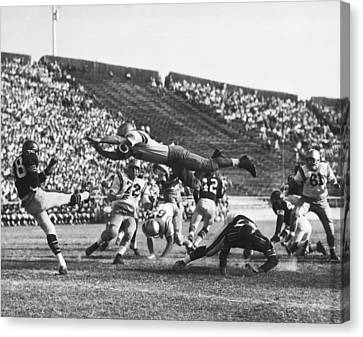 Player Blocks Football Punt Canvas Print by Underwood Archives