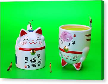 Playing Golf On Cat Cups Canvas Print by Paul Ge