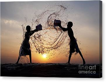 Playing With Water Canvas Print by Tim Gainey