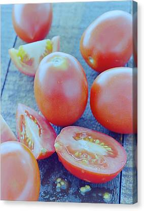 Plum Tomatoes On A Wooden Board Canvas Print by Romulo Yanes