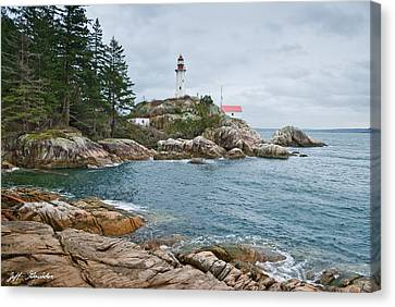 Canvas Print featuring the photograph Point Atkinson Lighthouse And Rocky Shore by Jeff Goulden