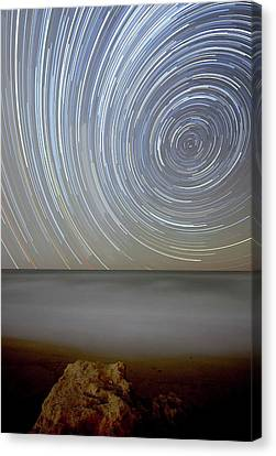 Polar Star Trails Over Coastal Waters Canvas Print by Luis Argerich