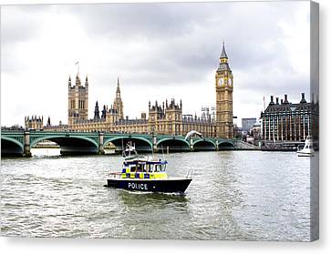 Police Boat On The River Thames Outside Parliment Canvas Print by Fizzy Image