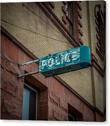 Police Station Sign Canvas Print by Paul Freidlund