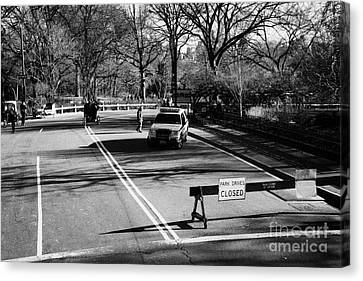 police SUV car patrol with park drives closed sign at the entrance to Central Park new york city Canvas Print by Joe Fox