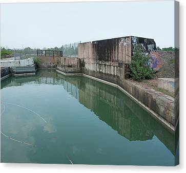 Polluted Industrial Site Canvas Print by Robert Brook