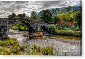 Pont Fawr 1636 Canvas Print by Adrian Evans