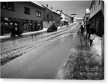 Spring Floods Canvas Print - pools of thawing water from ice on main shopping street storgata Honningsvag finnmark norway europe by Joe Fox