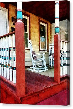 Porch With Red White And Blue Railing Canvas Print by Susan Savad