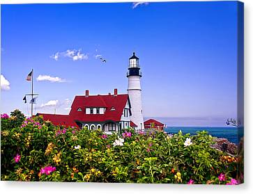 Portland Head Light And Roses Canvas Print by Mitchell R Grosky