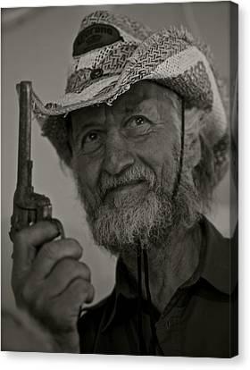 Portrait Of A Joyful Gunslinger . Viewed 244 Times  Canvas Print by  Andrzej Goszcz