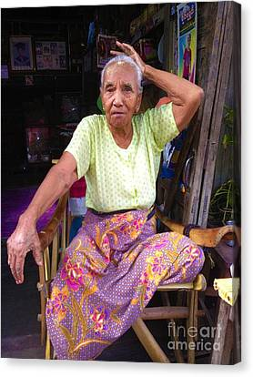 Canvas Print featuring the photograph Portrait Of Elderly Burmese Lady Sitting In Front Of Home 33rd Street Chanayethazan Mandalay Burma by Ralph A  Ledergerber-Photography