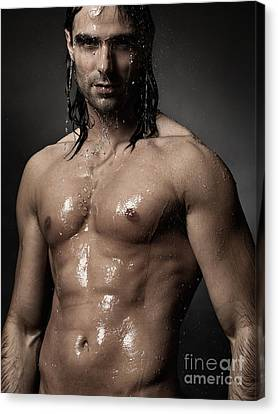 Portrait Of Man With Wet Bare Torso Standing Under Shower Canvas Print