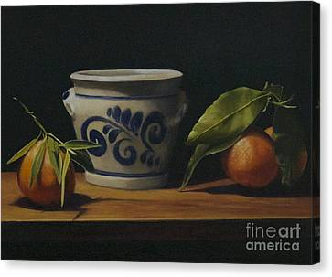 Pot And Clementines Canvas Print by Margit Sampogna