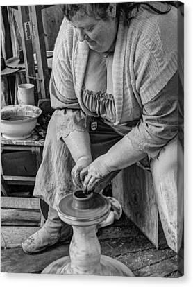 Potters Wheel V1 Canvas Print by John Straton