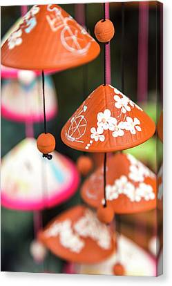 Close Focus Floral Canvas Print - Pottery Wind Chimes With Vietnamese by Peter Adams
