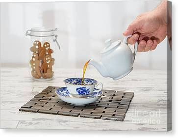 Pouring A Cup Of Tea Canvas Print by Amanda Elwell