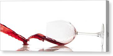 Pouring Red Wine In A Glass Canvas Print by Thomas Pfeller
