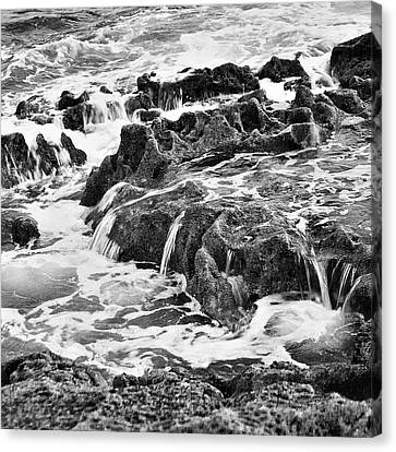 Pouring Rocks Canvas Print by David Davies