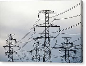 Power Lines To An Aluminium Smelter Canvas Print by Ashley Cooper