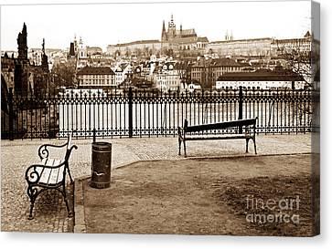 Prague Benches Canvas Print by John Rizzuto