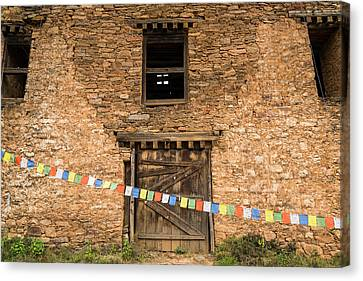 Prayer Flags In Front Of The Drukgyal Canvas Print by Ira Block