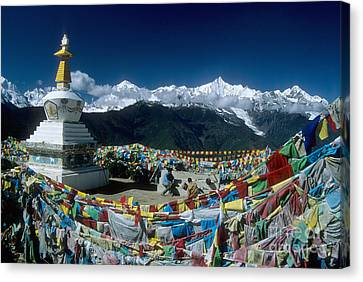 Prayer Flags In The Himalayan Mountains Canvas Print by James Brunker
