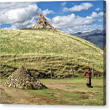 Tibetan Buddhism Canvas Print - Praying Tibetan by James Wheeler