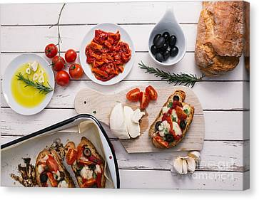 Preparing Italian Bruschetta Canvas Print by Viktor Pravdica