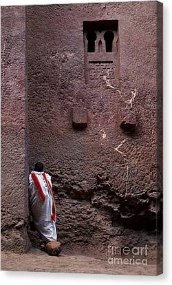 Priest Praying Outside Church In Lalibela Ethiopia Canvas Print