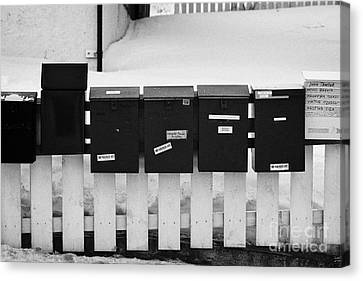 Private Mail Boxes On The Fence Outside An Apartment Block Kirkenes Finnmark Norway Europe Canvas Print by Joe Fox