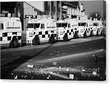Psni Armoured Land Rovers And Debris On Crumlin Road At Ardoyne Shops Belfast 12th July Canvas Print
